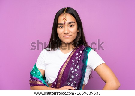 Young Indian woman with sari over isolated background