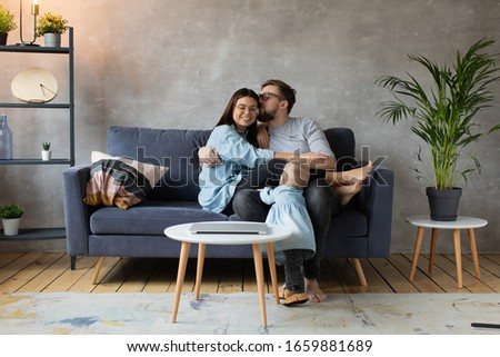 Young Family Playing Together on the Sofa. happy family. home comfort. #1659881689