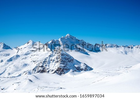 View on the snowy peaks Royalty-Free Stock Photo #1659897034