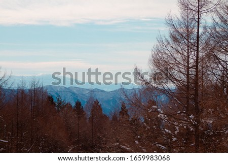 Fantastic winter landscape with mountains . Dramatic blue sky with full of clouds . #1659983068