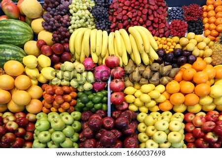 Various fresh summer exotic fruits for sale on market #1660037698