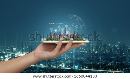 Smart city and Internet of things (IOT) on smartphone in hand, objects icon connecting together, Internet networking concept with background modern city blurred. Royalty-Free Stock Photo #1660044130