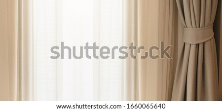 soft brown curtain with morning light from window bedroom background banner header size image Royalty-Free Stock Photo #1660065640