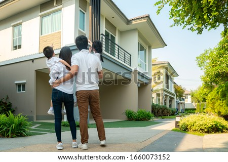 Beautiful family portrait smiling outside their new house with sunset, this photo canuse for family, father, mother and home concept #1660073152