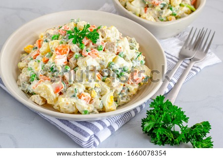 Traditional Russian salad Olivier in a Bowl High Angle, White Background, Popular Russian Food Horizontal Stock Photo #1660078354