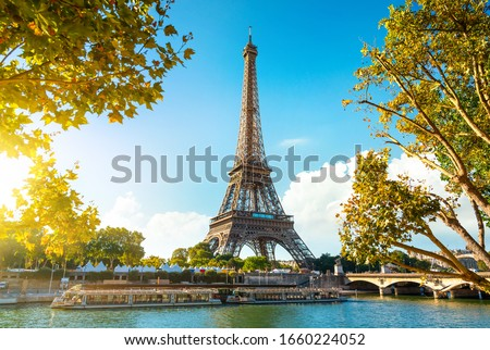 Seine in Paris with Eiffel Tower in sunrise time Royalty-Free Stock Photo #1660224052