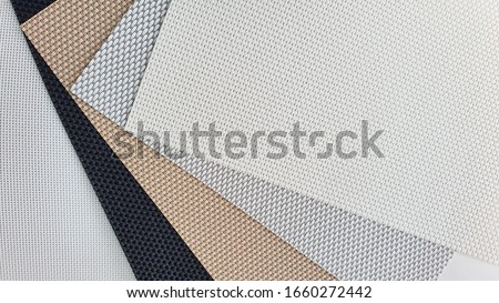 close up of fabric samples for roller blind curtain. Royalty-Free Stock Photo #1660272442
