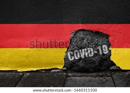 Flag of Germany on the wall with cracked stone with Coronavirus name on it. 2019 - 2020 Novel Coronavirus (2019-nCoV) concept, for an outbreak occurs in Germany. Royalty-Free Stock Photo #1660311100