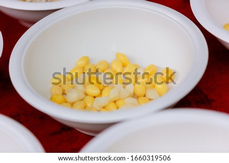 Ginkgo Nuts in Syrup and young Coconut in white bowl on napkin. Fresh Yellow Ginkgo in the blow. Ginkgo nuts (Ginkgo Biloba) have high nutrition and vitamin. Dessert menu,Dessert food  #1660319506