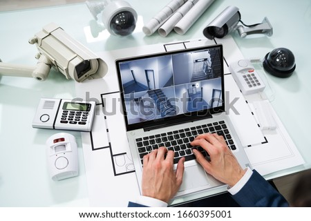 Person Monitoring Smart House On Digital Tablet Royalty-Free Stock Photo #1660395001
