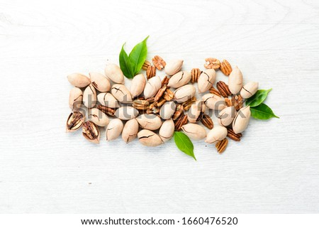 Delicious Pecan nuts on white background Wooden. Top view. Free space for your text. #1660476520