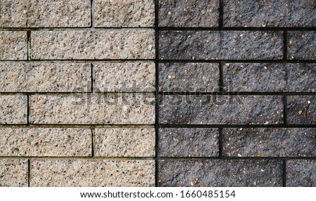 Light grey clay brick and mortar wall in. Live wallpaper background. Slow motion. Place for text, title Royalty-Free Stock Photo #1660485154