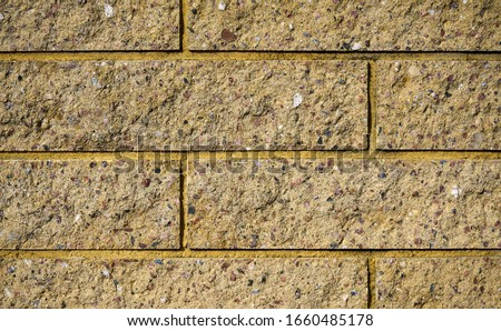 Yellow bricks wall. Bricks texure. Brick background. Royalty-Free Stock Photo #1660485178