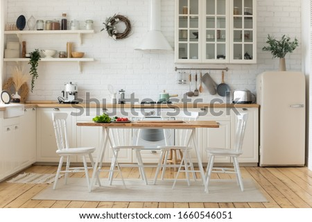 Interior design or bright white modern kitchen, fresh vegetables fruit wooden table, empty renovated furnished studio or flat apartment for rent, mortgage, real estate, renovation service concept #1660546051