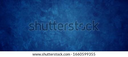 dark blue grunge cement wall background