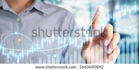 Businessman plan graph growth and increase of chart positive indicators in his business #1660640842
