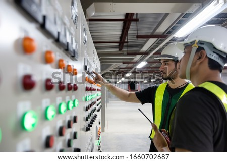 Electrical Engineer team working front HVAC control panels, Technician daily check controls system for security functions in service room at factory. Heating,Ventilation,Air Conditioning. Royalty-Free Stock Photo #1660702687