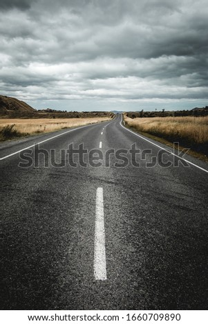Empty road. Asphalt road in landscape. Vertical road highway photo. Leading lines of road. Transport and travel concept. #1660709890