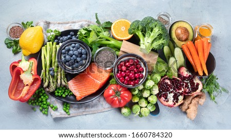 Healthy food selection on gray background. Detox and clean diet concept. Foods high in vitamins, minerals and antioxidants. Anti age foods. Top view #1660784320