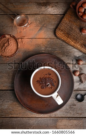 Cup of hot chocolate on wooden table Royalty-Free Stock Photo #1660805566