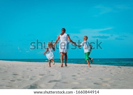mother with kids play, family run on tropical beach #1660844914