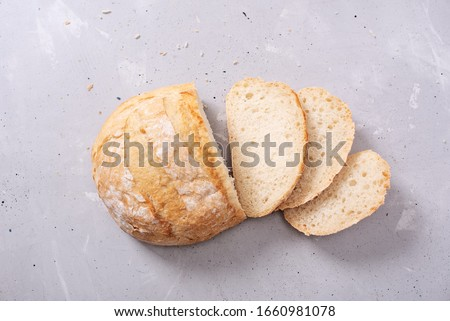 Fresh homemade crisp bread, top view. French bread. Bread at leaven. Unleavened bread. #1660981078