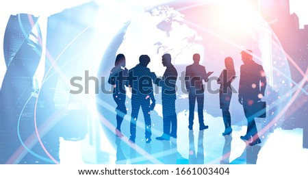 Silhouettes of business people in blurry Moscow city with double exposure of planet hologram. Concept of international business partnership and teamwork. Toned image. Elements furnished by NASA #1661003404