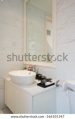 the sink and mirror in a modern bathroom #166101347