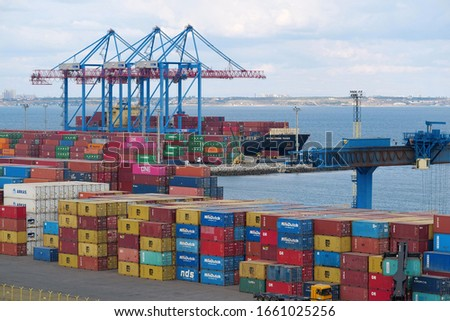 ODESSA, UKRAINE, SEPTEMBER 7, 2019: Cranes and containers in Odessa port - largest Ukrainian seaport and one of largest ports in Black Sea basin #1661025256