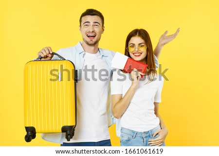 cheerful young couple travel vacation passports plane tickets airport family passengers #1661061619