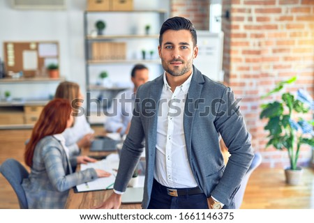 Group of business workers working together. Young handsome businessman standing smiling happy looking at the camera at the office #1661146375