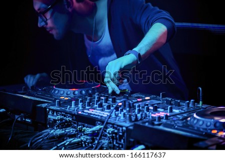 Dj mixes the track in the nightclub at party #166117637