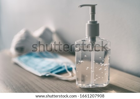 Coronavirus prevention medical surgical masks and hand sanitizer gel for hand hygiene corona virus protection. Royalty-Free Stock Photo #1661207908