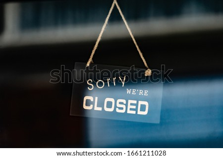 sorry we are closed sign hanging outside a restaurant, store, office or other #1661211028