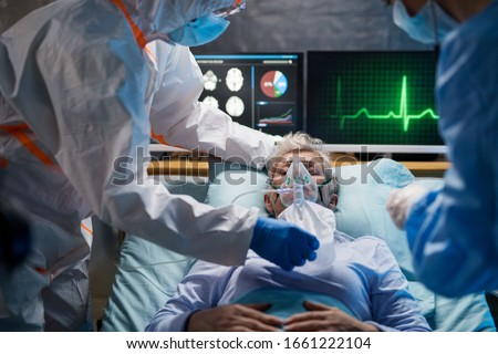 Infected patient in quarantine lying in bed in hospital, coronavirus concept. Royalty-Free Stock Photo #1661222104