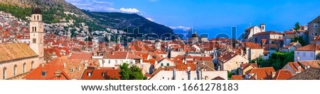 Landmarks and travel in Croatia - beautiful Dubrovnik town, view of historic center from the city wall #1661278183