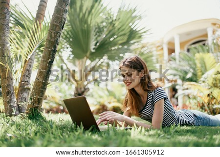 woman young girl with laptop outdoors in a t-shirt #1661305912