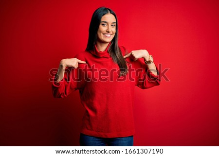 Young beautiful brunette woman wearing casual sweater over isolated red background looking confident with smile on face, pointing oneself with fingers proud and happy. #1661307190