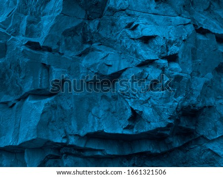 Blue green abstract grunge background. Toned rock texture. Texture of the mountains closeup. The combination of bright color and rough rocky shape.                          Royalty-Free Stock Photo #1661321506