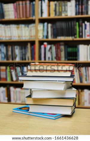 Stack of Books on the table in library #1661436628