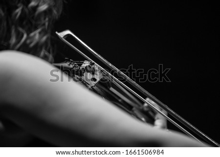 Closeups of people playng strings instruments. Black and white photos isolated  #1661506984