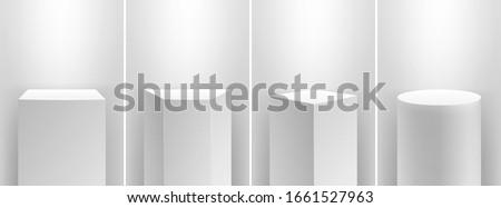 Museum stage. Realistic cubes podium, 3d exhibit displays. Gallery geometric blank product stands. Spotlight illuminates pedestal vector set #1661527963