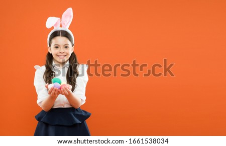 small girl wearing bunny ears. kid on easter egg hunt. happy child hold painted egg. having fun on spring holiday. schoolgirl in rabbit ears. Easter eggs. copy space. happy easter. easter sale. #1661538034
