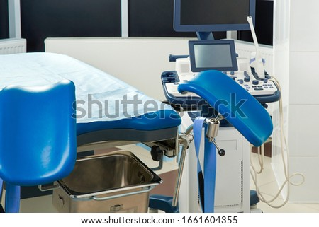 Gynecological room with chair and equipment #1661604355
