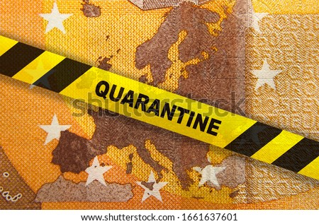 Coronavirus quarantine in Europe. Travel restrictions. 50 Euro banknote with EU map and tape. Economy and financial markets affected by corona virus outbreak and pandemic fears. Montage. Royalty-Free Stock Photo #1661637601