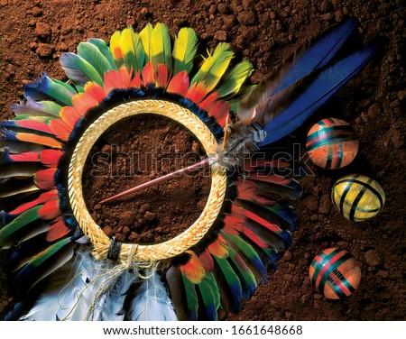 Brazilian Indian headdress, beatiful, colorful, over earth Royalty-Free Stock Photo #1661648668