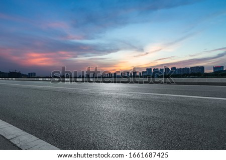 Asphalt road and modern city commercial buildings in Beijing, China #1661687425