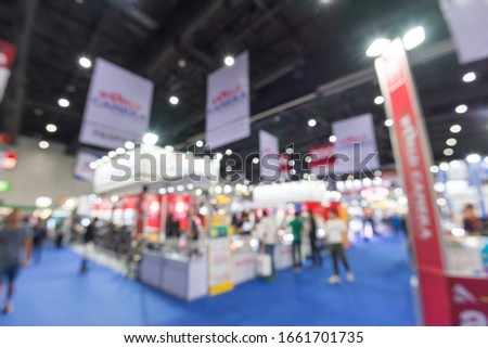 Abstract blur people in exhibition hall event trade show expo background. Large international exhibition, convention center, Business marketing and MICE industry concept. #1661701735
