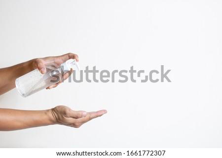 using alcohol gel clean wash hand sanitizer anti virus bacteria dirty skin care Royalty-Free Stock Photo #1661772307