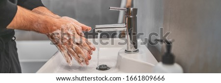 Corona virus travel prevention wash hands with soap and hot water. Hand hygiene for coronavirus outbreak. Protection by washing hands frequently concept panoramic banner header.